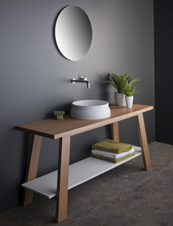 Latis round basin on trestle with solid surface shelf
